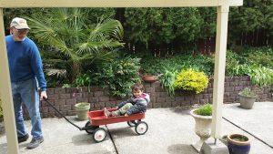 My son getting a wagon ride with Grandpa.